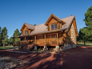 Amazing Solid Log Ranch On 5 acres Backing To San Franscico Peaks