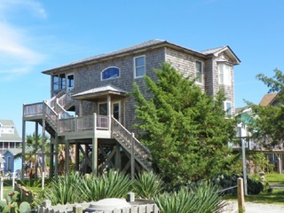 An island jewel, waterfront property with boat docking perfect for a couple or family of four.