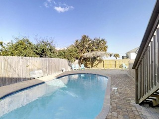 Coastal 4 bedroom home with Private pool, fenced yard and just steps to the beach