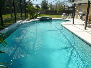 Gorgeous 4 bedroom Vacation Home close to Disney and Orlando in Clermont with private pool and spa